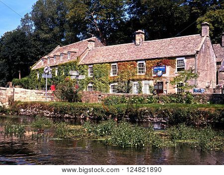 BIBURY, UK - AUGUST 12, 1991 - The Swan Hotel seen across the River Coln Bibury Gloucestershire England UK Western Europe, August 12, 1991.