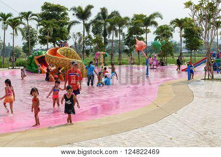 Kanchanaburi, Thailand - March 30, 2016: People enjoy playing new waterpark open in Kanchanaburi province, Thailand
