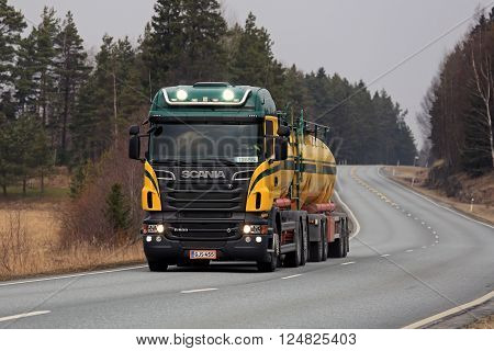 SALO FINLAND - MARCH 28 2016: Colorful Scania R500 tank truck on the road in South of Finland. Scania celebrates 125 years in 2016.