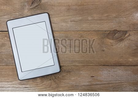 gray ebook lays on aged wood flat lay