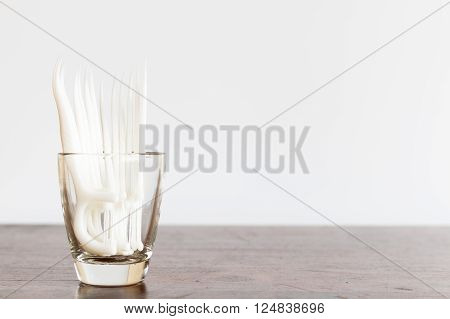 Oral Device : Dental Floss In Glass On Wooden Background