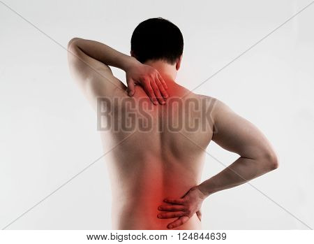 Backache on male body. Young person suffering from lumbar vertebrae disease.
