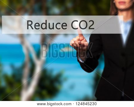 Reduce Co2 - Businesswoman Hand Pressing Button On Touch Screen Interface.
