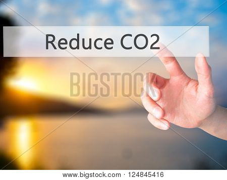Reduce Co2 - Hand Pressing A Button On Blurred Background Concept On Visual Screen.