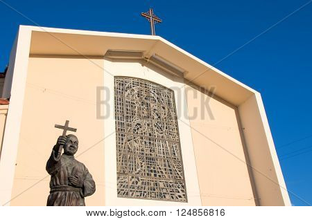 San Gabriel Californa USA/April 3 2016: Photo of Mission San Gabriel Arcangel with statue of Junipero Serrawhich is locSan Gabriel Californa USA.ated in