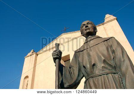 April 3 2016: Photo of Mission San Gabriel Arcangel with statue of Junipero Serrawhich is located in San Gabriel Californa USA.