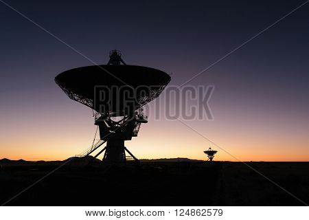 Sunrise Huge antenna dish at Very Large Array searching for imaging signal in space silhouette