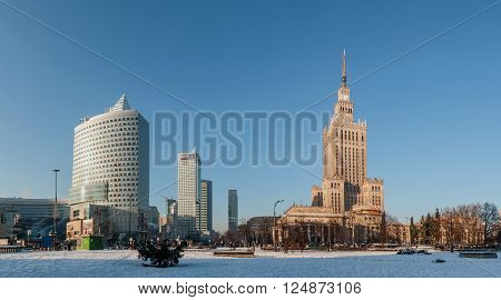 WARSAW, POLAND - JANUARY 23, 2016: Panorama of Warsaw city center with Palace of Culture and Science (PKiN), a landmark and symbol of Stalinism and communism, and modern skyscrapers in winter at sunset