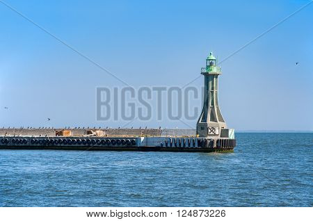 Small lighthouse - harbor entrance light on the groin in Gdynia Poland