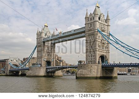 LONDON UNITED KINGDOM - APRIL 09: Tower Bridge in London on APRIL 09 2010. Bascule Tower Bridge Over Thames River in London United Kingdom.