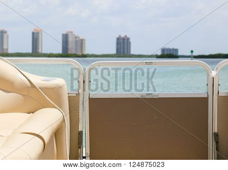 FORT MYERS BEACH, USA - MAY 11, 2015: Interior of a pontoon boat going on Estero Bay towards some highrise buildings.