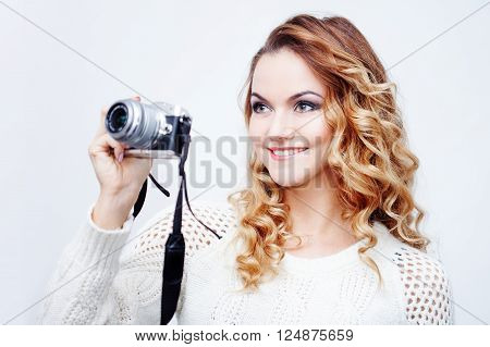 young  woman photographer with camera, portrait on the white background