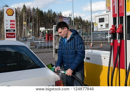 Saint-Petersburg Russia - April 7 2016: A man 30-35 years fills his car with petrol at a petrol station Shell