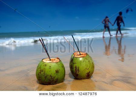coconut cocktail on beach sand