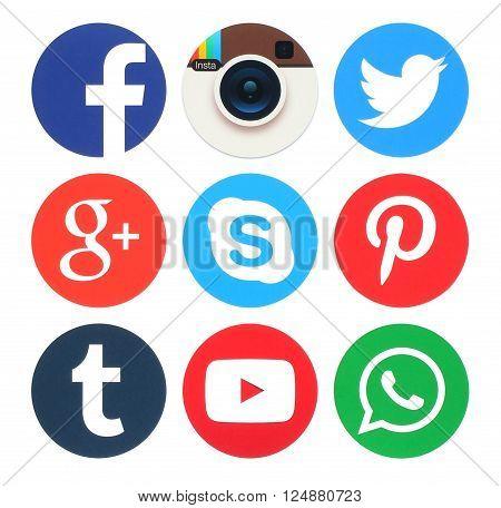 Kiev Ukraine - March 23 2016: Collection of popular round social media logos printed on paper:Facebook Twitter Google Plus App Insta Instagram Skype Pinterest Tumblr Youtube and WhatsApp