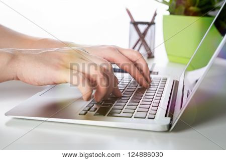 Man Working With Modern Laptop In Office