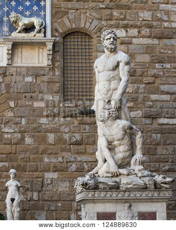 Hercules and Cacus statue by Bandinelli (1534) located on the Piazza della Signoria in Florence Italy. Concepts could include art history mythology power others.