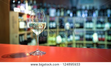 A fizzy wine glass on the bar counter.