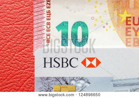 PARIS FRANCE - MAR 22 2015: Ten Euro paper currency detail on leather seats of a sport car coverd with HSBC card