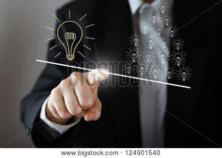 Businessman's hand pressing the icon on virtual screen drawing many small idea have more weight than one big idea. Business, technology, internet and networking concept. Copy space