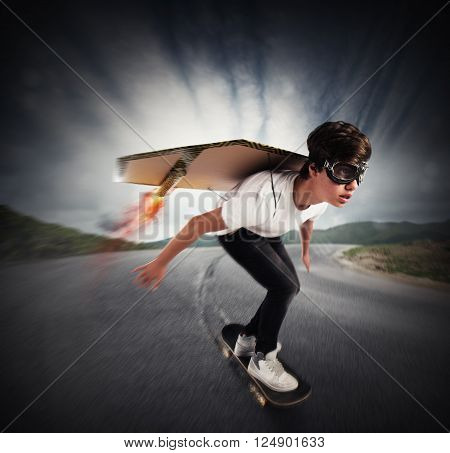 Boy goes on skate with cardboard wings