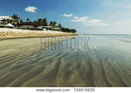 BALI, INDONESIA APRIL 3, 2016: Amazing beach Kuta in Indonesia with blue sky