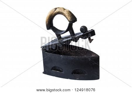 Old coal iron with wood handle isolated on white