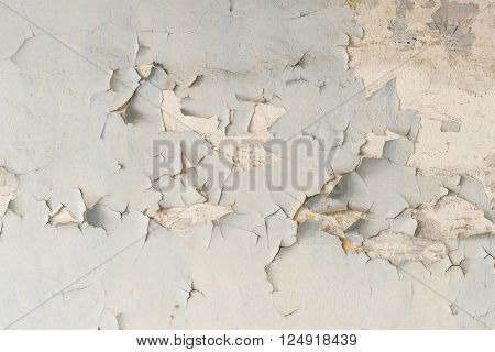 Abstract texture of the peeled-off paint. Old peeling painted wall.