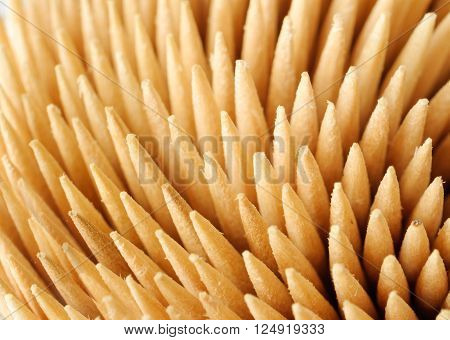 Veer a bunch of wooden toothpicks. Closeup. care product.