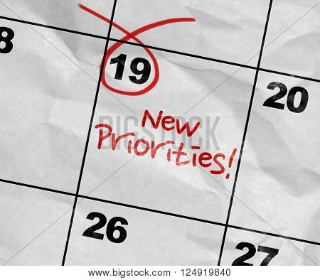 Concept image of a Calendar with the text: New Priorities poster