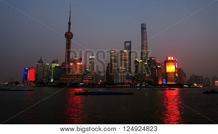 SHANGHAI, CHINA - JANUARY 19, 2016: Shanghai Skyline at night, Pudong, Huangpu River, Oriental Pearl Tower, Jin Mao Tower, Shanghai International Finance Centre, Shanghai World Financial Center