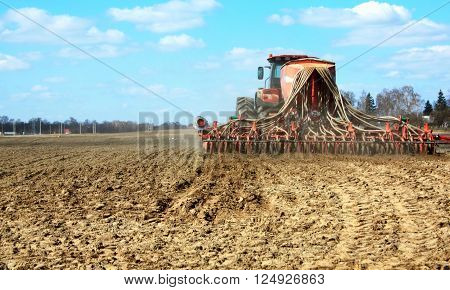 spring sown spring crops on a ploughed field in a mechanical way