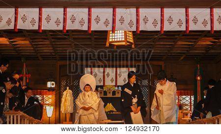 MATSUMOTO JAPAN - NOVEMBER 21 2015: Unidentified Japanese groom and bride attend a Japanese traditional wedding ceremony at Yohashira shrine