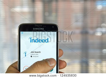MONTREAL CANADA - APRIL 7 2016 : Indeed job search application on a cell phone. Indeed is a global online employment solution for people seeking jobs.