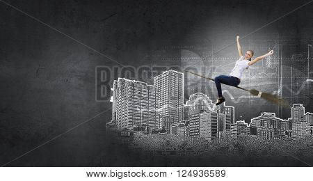 Woman fly on besom