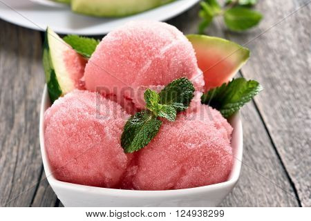 Watermelon sorbet ice cream in bowl close up view