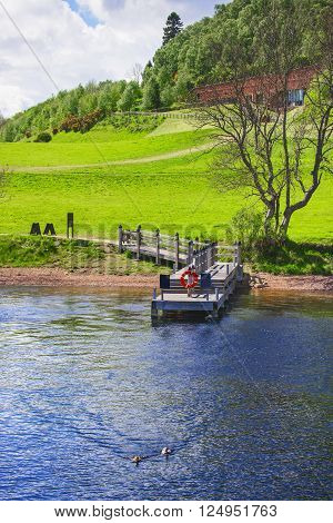Pier in Loch Ness in Scotland. Loch Ness is a city in the Highlands in Scotland in the United Kingdom.