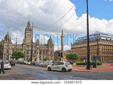 GLASGOW SCOTLAND - MAY 8 2011: Street view to Glasgow City Chambers in George Square in Glasgow. Glasgow is the city in the Lowlands in Scotland in the United Kingdom.