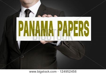 panama papers sign is held by businessman