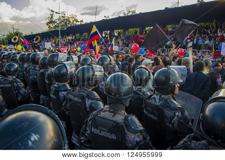 Quito, Ecuador - April 7, 2016: Police awaiting overlooking peaceful anti government protests in Shyris Avenue, beautiful blue sky and buildings background.