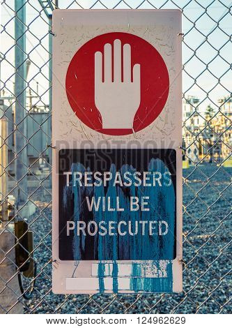 Trespassers Will Be Prosecuted Sign Outside An Electrical Power Transformer Substation