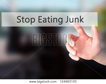 Stop Eating Junk - Hand Pressing A Button On Blurred Background Concept On Visual Screen.