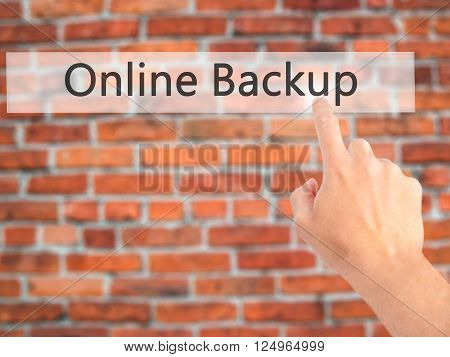 Online Backup - Hand Pressing A Button On Blurred Background Concept On Visual Screen.