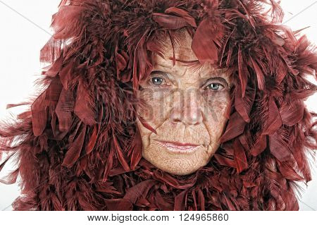 A very Fun Image of a senior Glamour woman with red feathers.