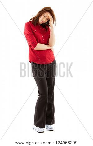 Worried, stressed young woman isolated over white background, full body shoot