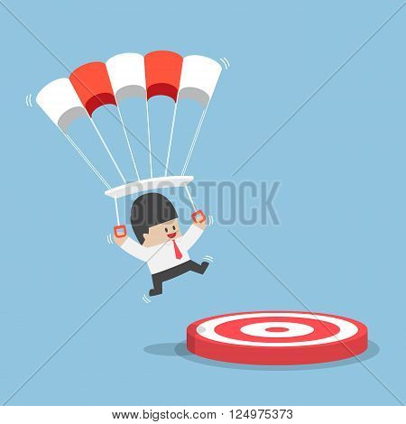 Businessman With A Parachute Focus To Landing On A Target