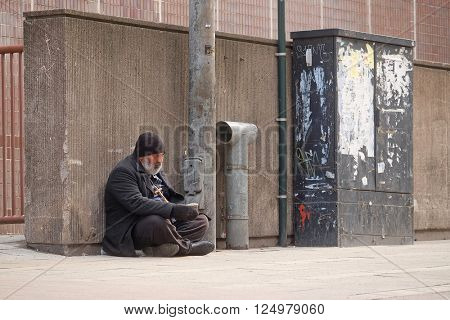 Helsinki, Finland - April, 4, 2016: homeless person in a center of Helsinki, Finland.