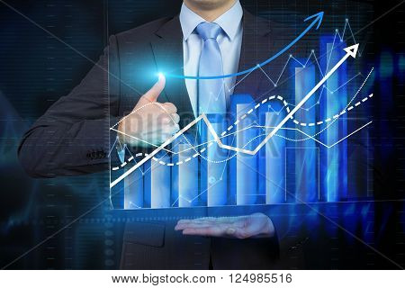 Businessman holding bar chart and graphs drawn on virtual screen thumb raised up. Chest view. Concept of business analysis.