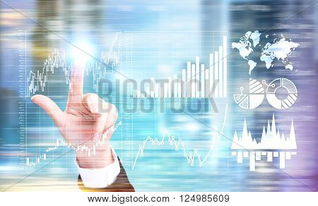 Hand touching graphs and diagrams on virtual screen. Double exposure. Concept of data analysis.