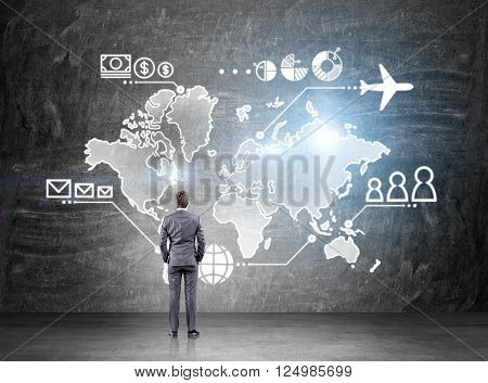 Businessman standing in front of map drawn on blackboard money people and communication pointsvand plane on it. Concept of business logistics.